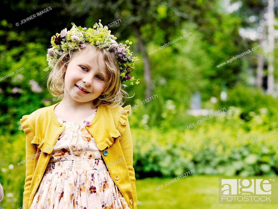 Stock Photo: Smiling girl wearing midsummer wreath.