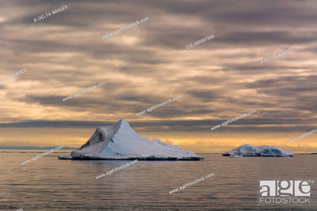 Stock Photo: Seascape with icebergs and storm clouds, Vibebukta, Austfonna, Nordaustlandet, Svalbard, Norway.