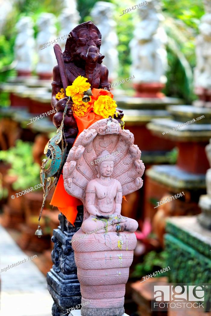 Stock Photo: Sculpture of divine beings in Thailand with fotografirovanie in Buddhist temples.