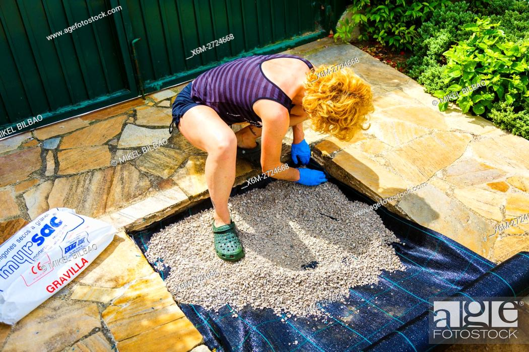 Stock Photo: Garden works. Filling up with gravel.