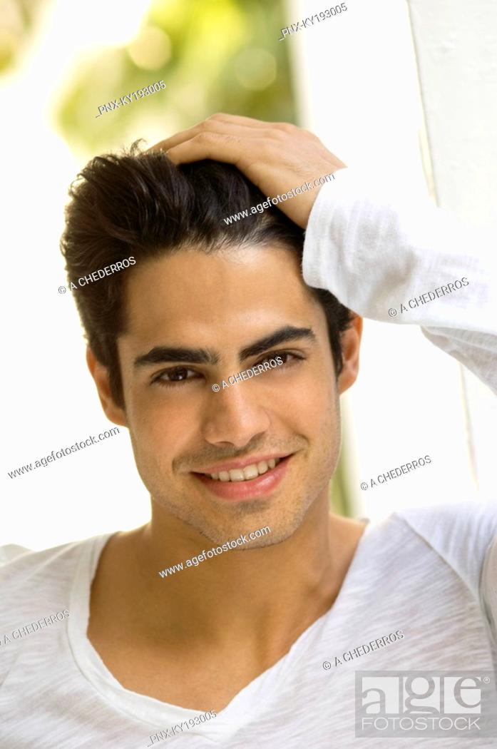 Stock Photo: Portrait of a man with his hand in his hair.