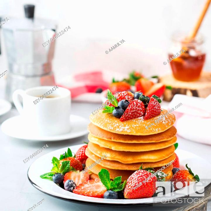 Stock Photo: Food and drink, still life, healthy nutrition concept. Stack of homemade pancakes for breakfast with berries and sugar. Light kitchen background.