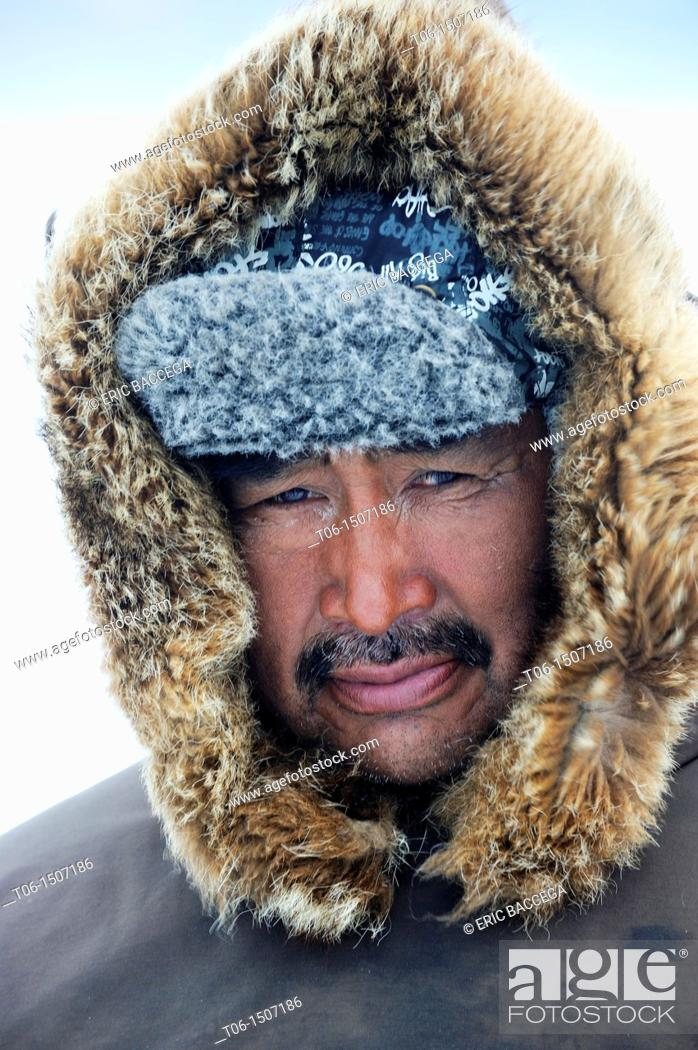 Stock Photo: Portrait of Inuit hunter with a fur hat, Floe Edge, Arctic bay, Baffin Island, Nunavut, Canada.
