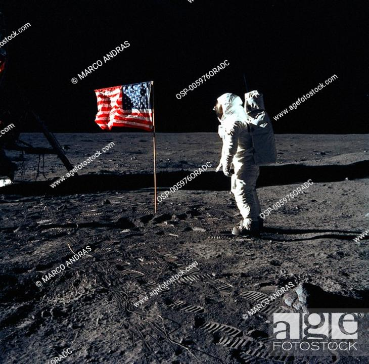 Stock Photo: a person astronaut looking the american flag.
