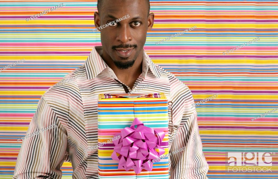 Stock Photo: African American man with birthday present.