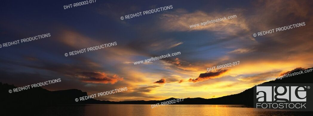 Stock Photo: Landscape view with body of water at dusk.