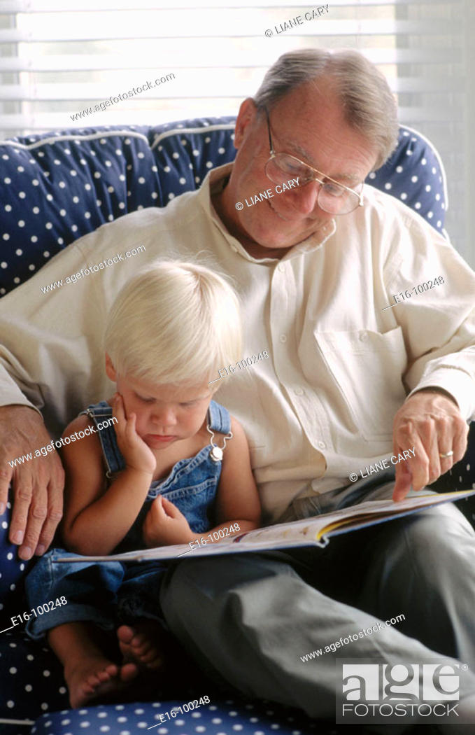 Stock Photo: Grandfather reading to grandson.