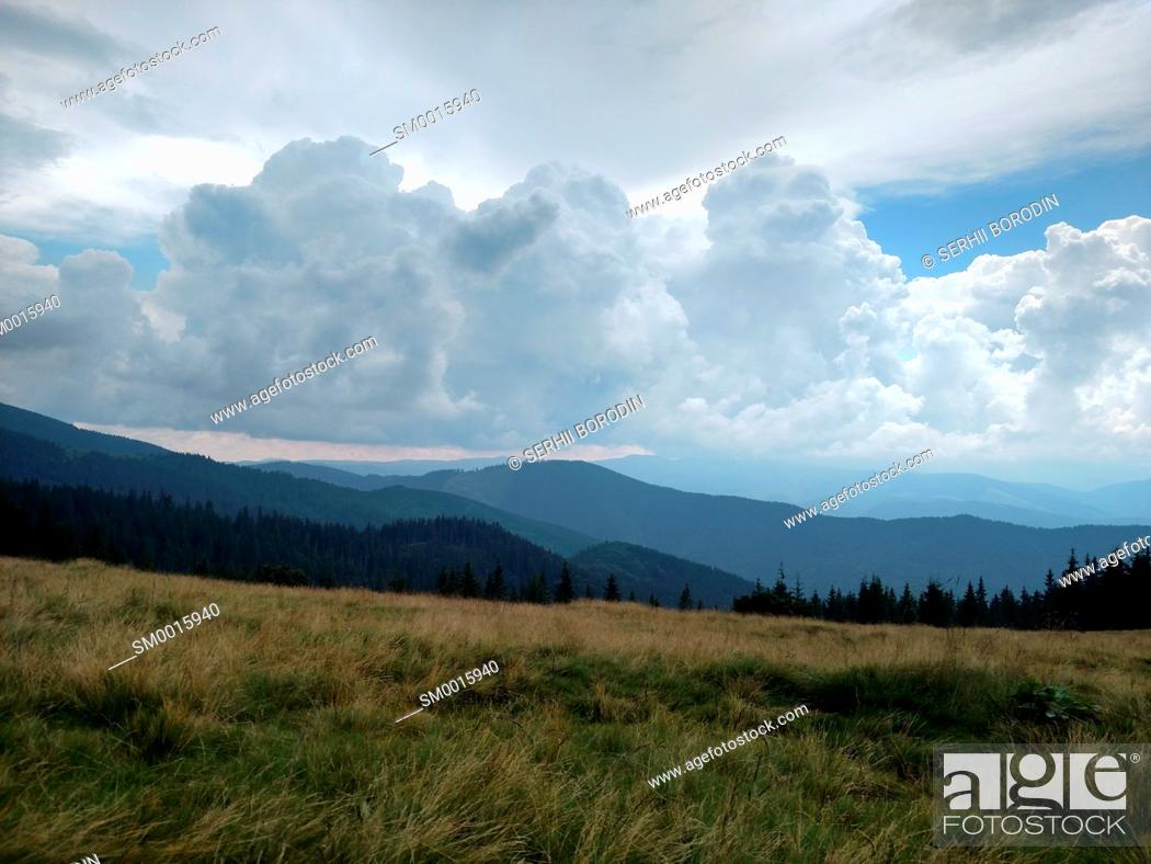 Stock Photo: Mountains ate clouds and lawn Grassland with dry grass nature.