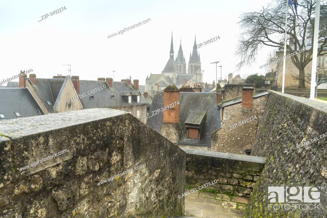 Stock Photo: Saint-Nicolas church and roofs of the medieval town Blois in Loire valley , France.