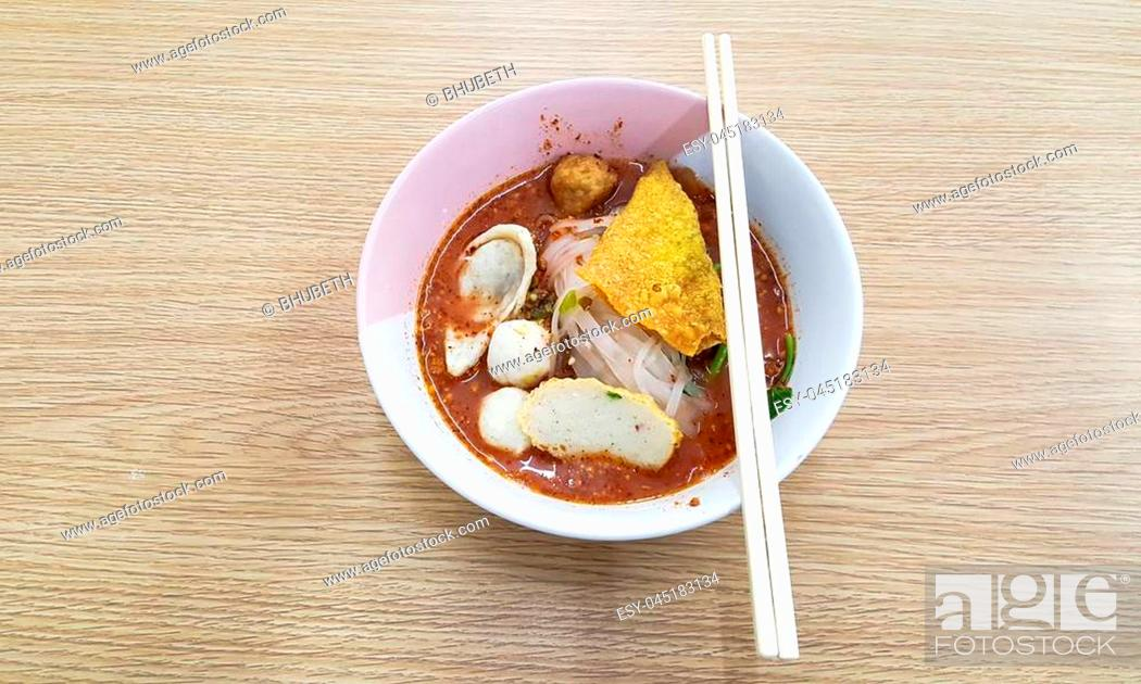 Stock Photo: Noodle bowl placed on a wooden table.