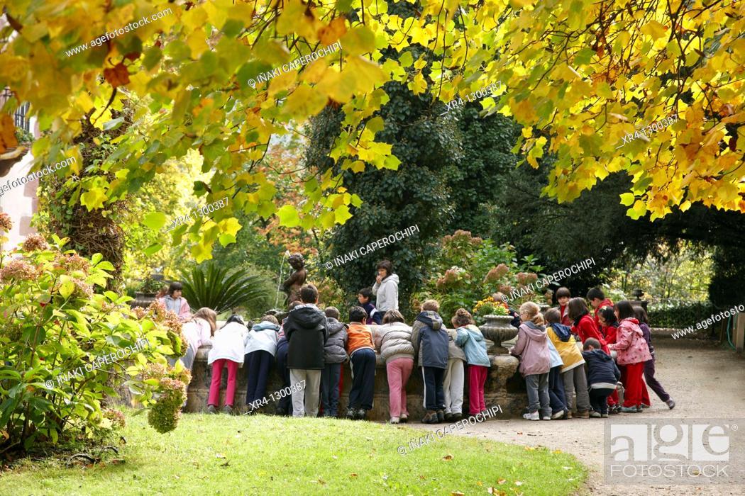 Stock Photo: Children at fountain, Señorio de Bertiz Natural Park, Oieregi, Navarre, Spain.