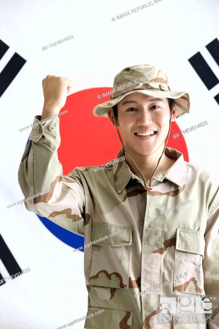 Stock Photo: explorer in front of Korean flag, Taegeukgi.