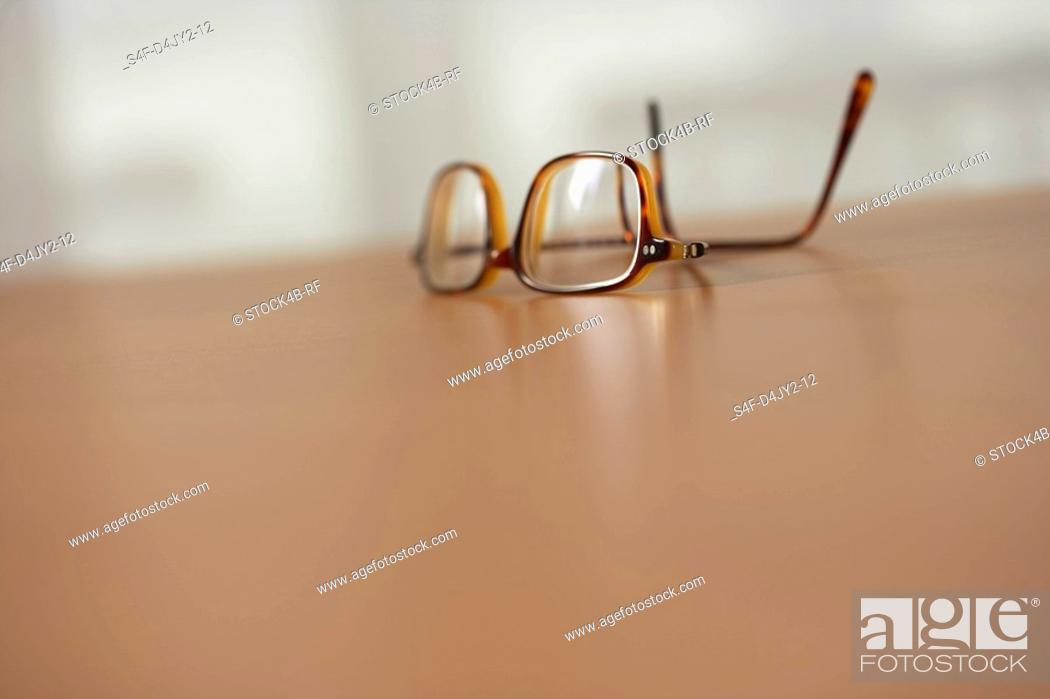 Stock Photo: Spectacles on a table.