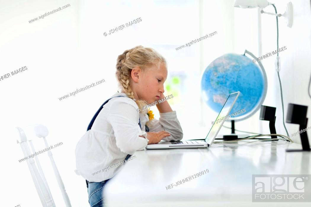 Stock Photo: Girl working on laptop.