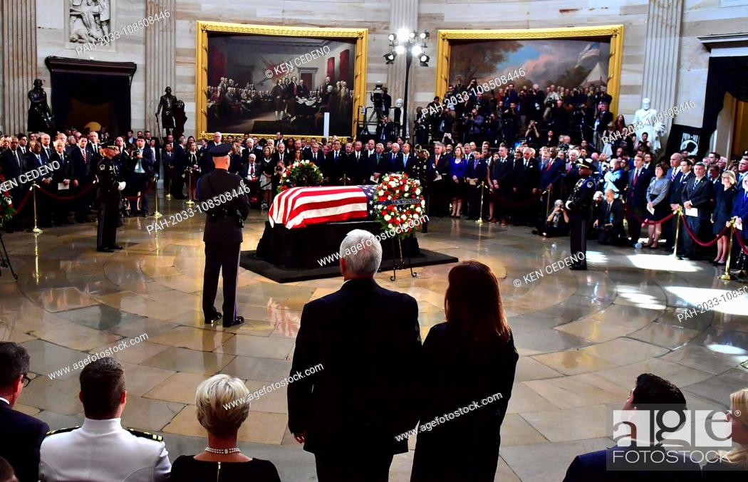 Stock Photo: Vice President Mike Pence and his wife Karen stand to honor Sen. John McCain, R-Ariz., during his memorial service in the Capitol Rotunda where he will lie in.