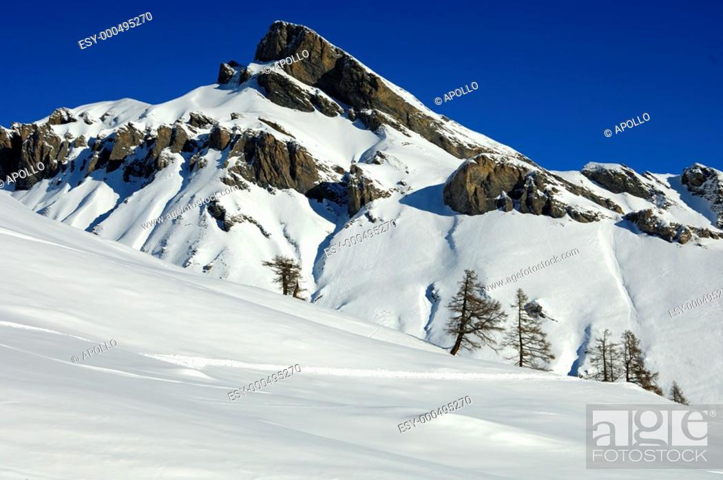 Stock Photo: Rocky peak towering snow-covered mountain slopes, Ovronnaz, Valais, Switzerland.