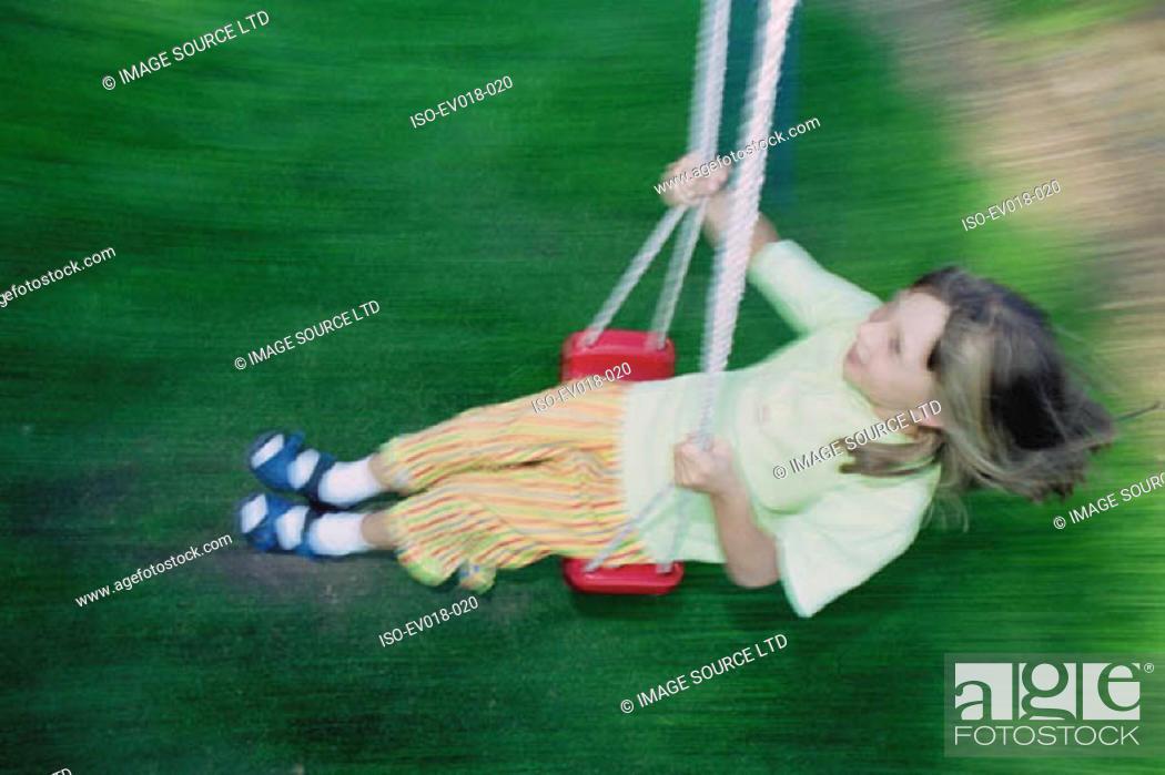 Stock Photo: Girl on swing.