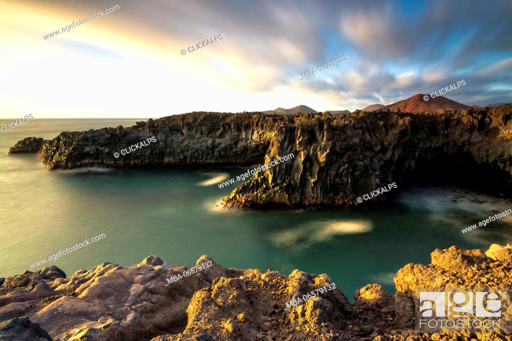 Stock Photo: Los Hervideros - Yaiza, Lanzarote Los hervideros is characterized by rocky cliffs overlooking the Atlantic and in the background the volcanoes.