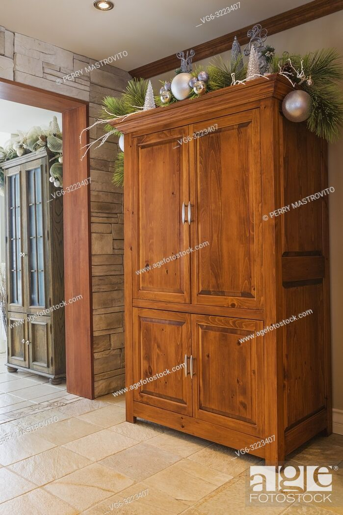 Stock Photo: Old pinewood armoire in kitchen inside an old renovated circa 1840 Canadiana cottage style home.