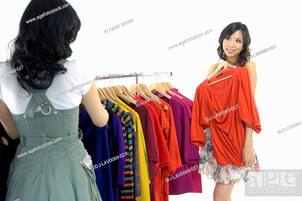 Stock Photo: Women choosing clothes in a clothing store.