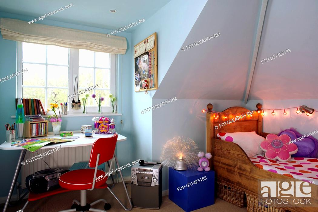 Stock Photo Ager S Pastel Blue Attic Bedroom With Novelty Fairy Lights Above Wooden