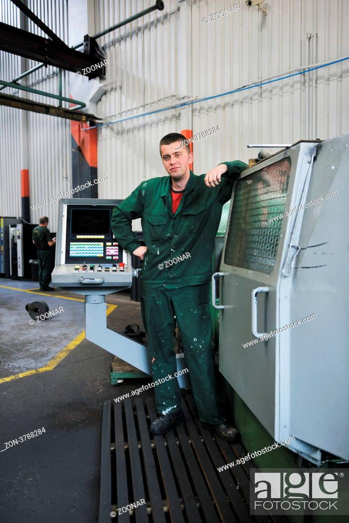 Stock Photo: engineering people manofacturing industry with big modern computer mashines i company hall.