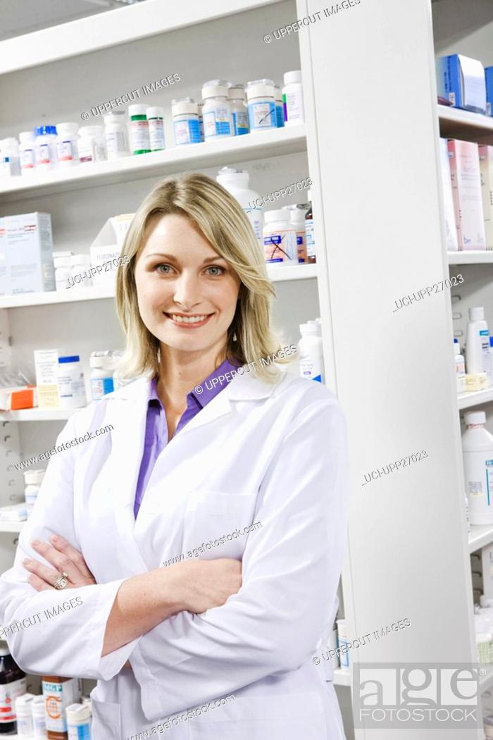 Stock Photo: Portrait of smiling pharmacist with arms crossed.