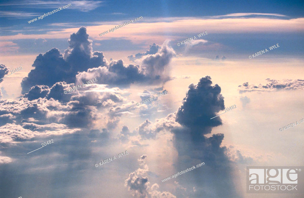Stock Photo: Dramatically colored and shaped clouds, seen from jet plane.