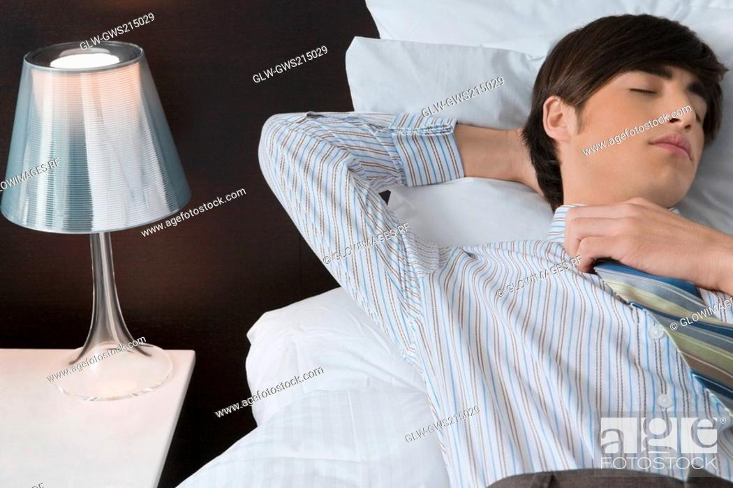 Stock Photo: Businessman sleeping on the bed.