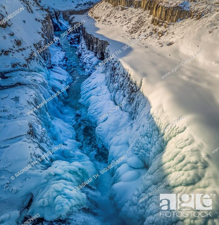 Stock Photo: Gullfoss waterfall, wintertime, Iceland. Gullfoss translated means Golden Falls. This image is shot with a drone.