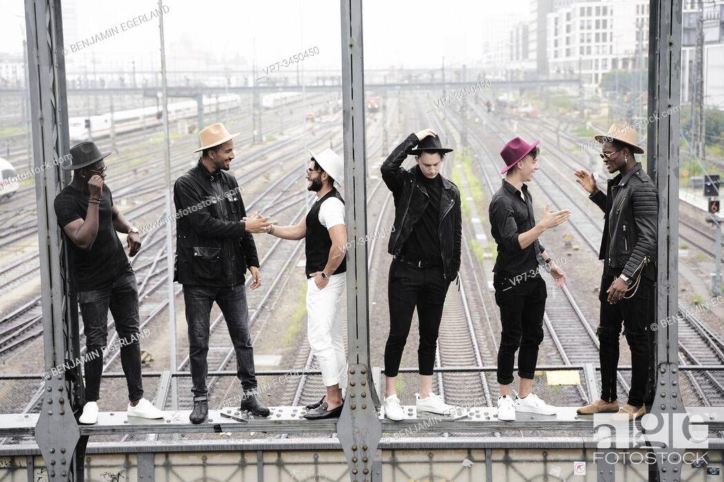 Stock Photo: Multiracial group of friends on bridge. Munich, Germany.