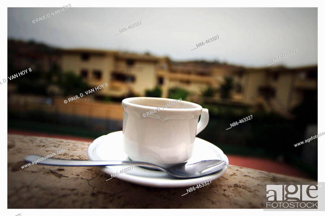 Stock Photo: Coffee cup and saucer on ledge in Sicily. Italy.