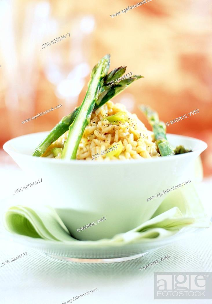 Stock Photo: Risotto with lobster bisque and asparagus.