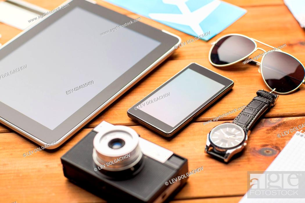 Stock Photo: vacation, travel, tourism, technology and objects concept - close up of smartphone and personal stuff.