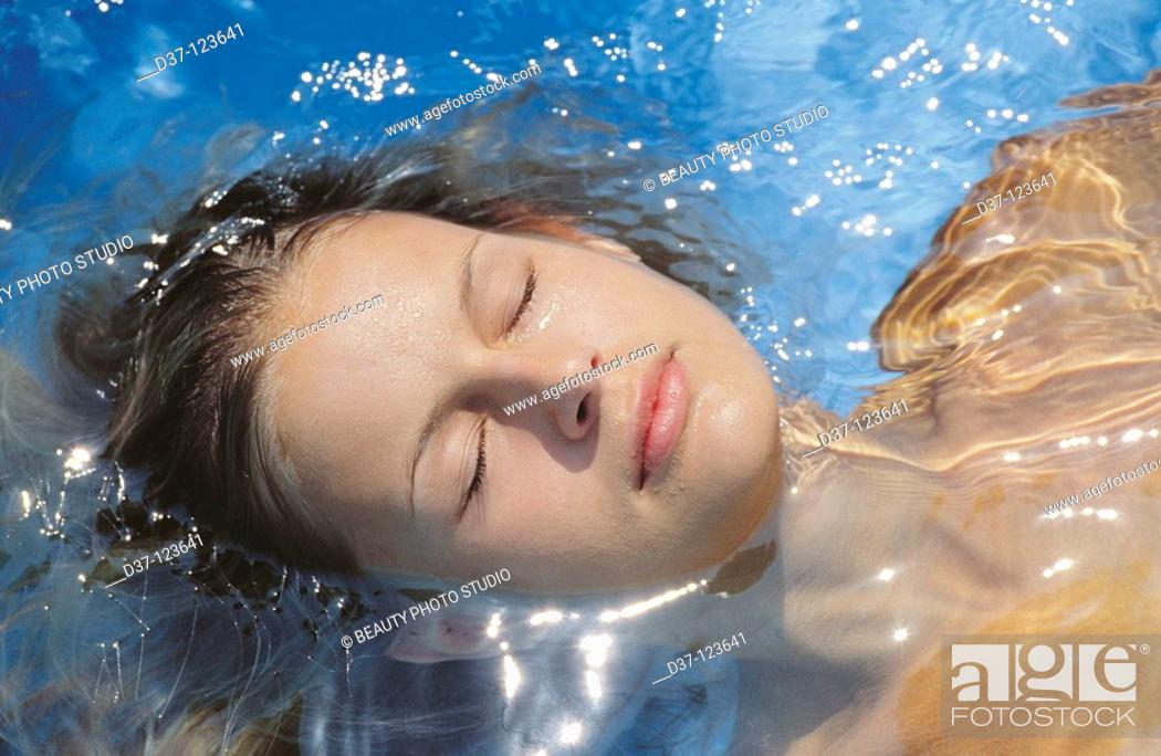 Stock Photo: Woman in the swimming pool.