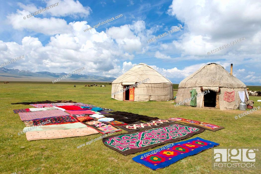 Stock Photo: Kyrgyzstan, Naryn Province, rugs in front of yurts on mountain pastures at Song-Kol lake state zoological reserve.