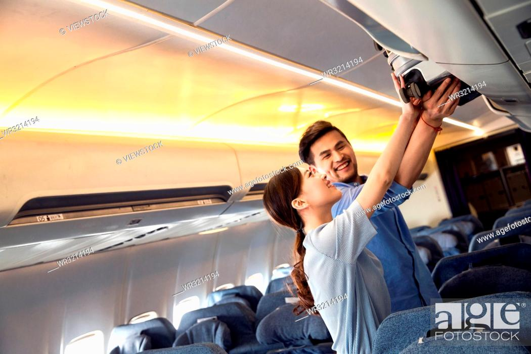 Stock Photo: Young couples to travel by plane.