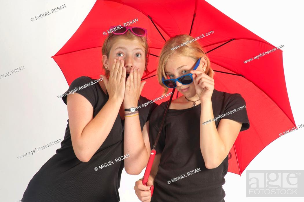 Stock Photo: Two young German girls under an umbrella.