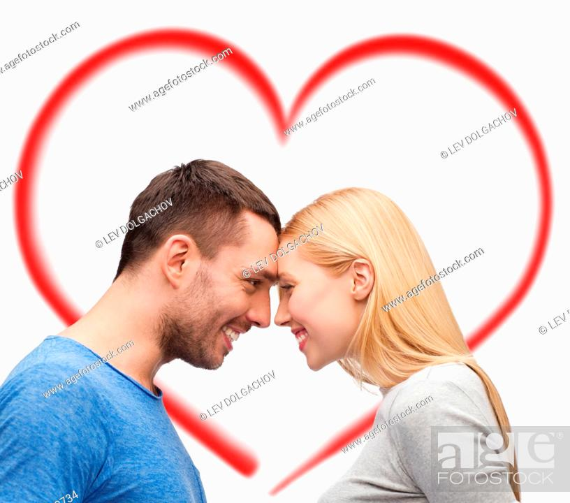 Stock Photo: love and family concept - smiling couple looking at each other.