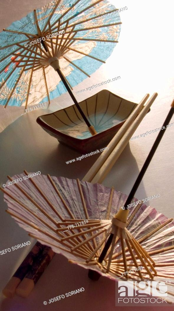 Stock Photo: Chopsticks and oriental umbrellas.