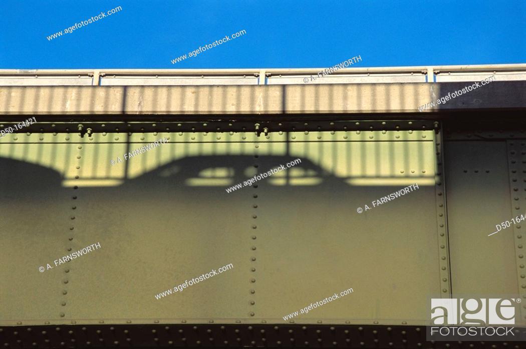 Stock Photo: Shadow of cars on bridge.