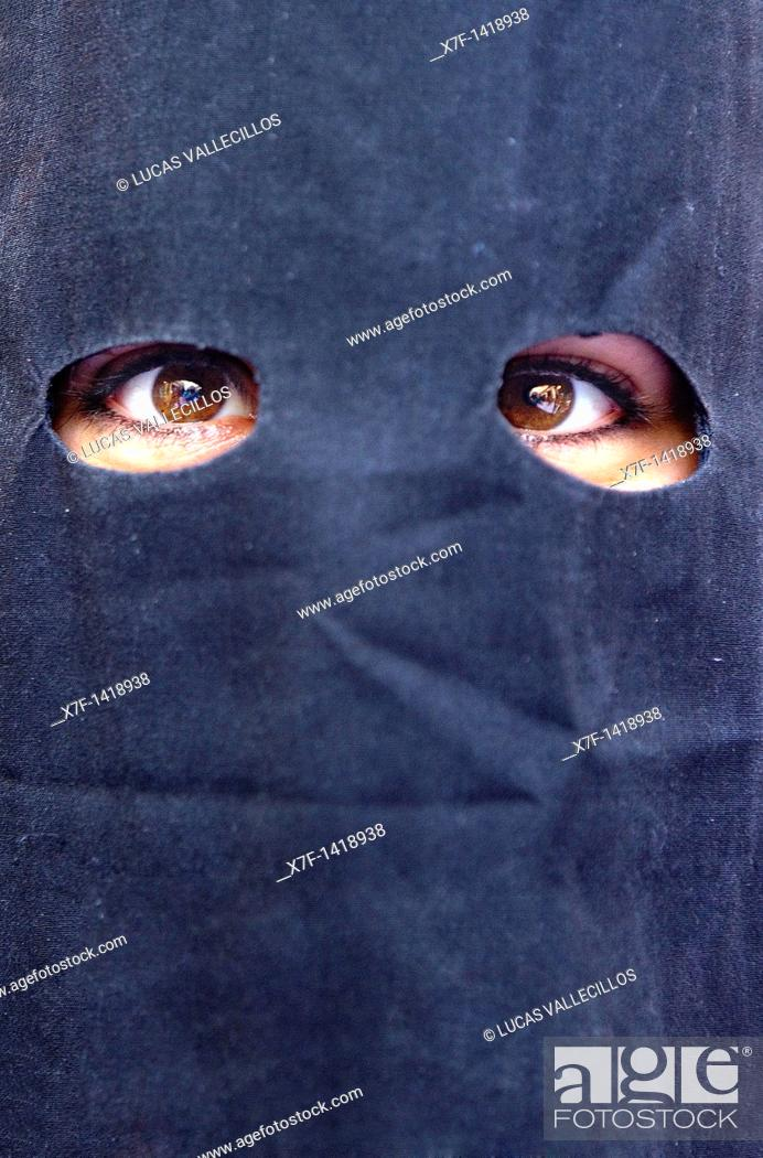 Stock Photo: Eyes of a peniente Holy Week procession `La Sed' Holy Wednesday  Seville  Spain.
