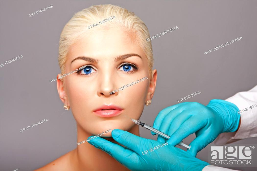 Stock Photo: Beautiful face of young woman for Aesthetics facial skincare concept anti-wrinkle botox restylane injection by cosmetic plastic surgeon beautician.