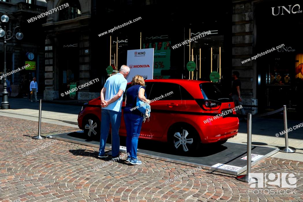Stock Photo: Inauguration of the Milano Monza Open-air Motorshow (MIMO) in Piazza del Duomo in Milan, Italy. 62 car manufacturers display their new hybrid and electric.