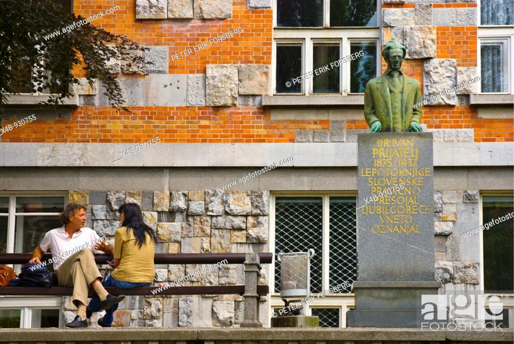 Stock Photo: Couple in front of the National and University Library by Plecnik in Ljubljana Slovenia Europe.