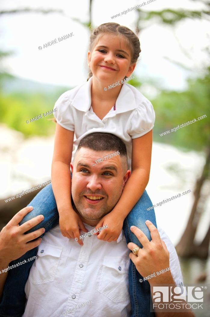 Stock Photo: Father letting his daughter ride on his shoulders.