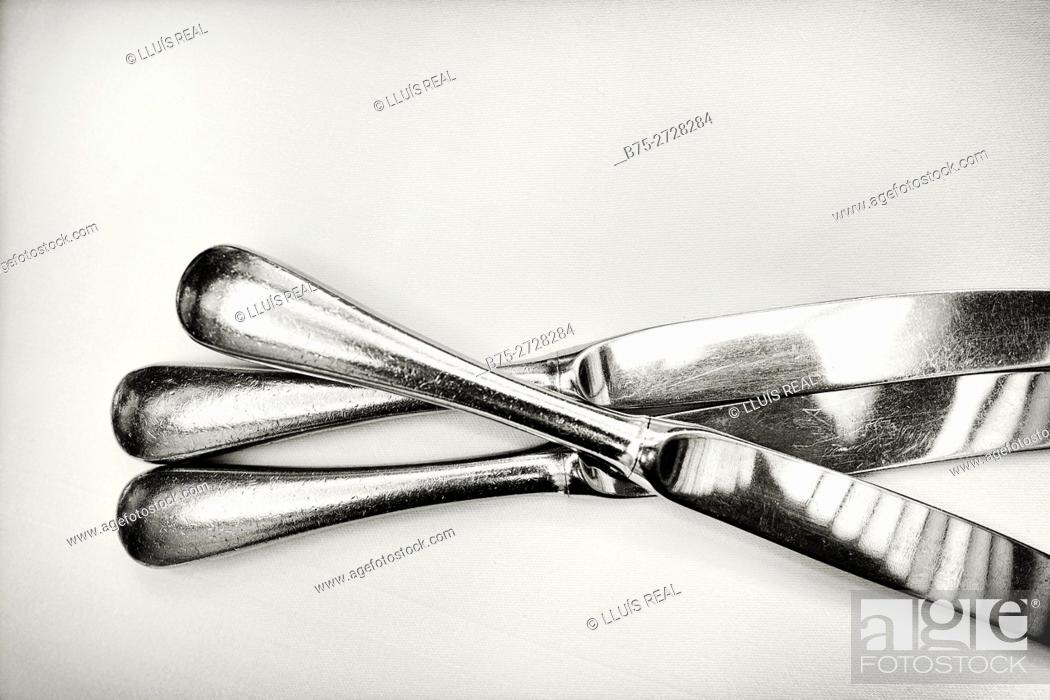 Stock Photo: Three knives on table.