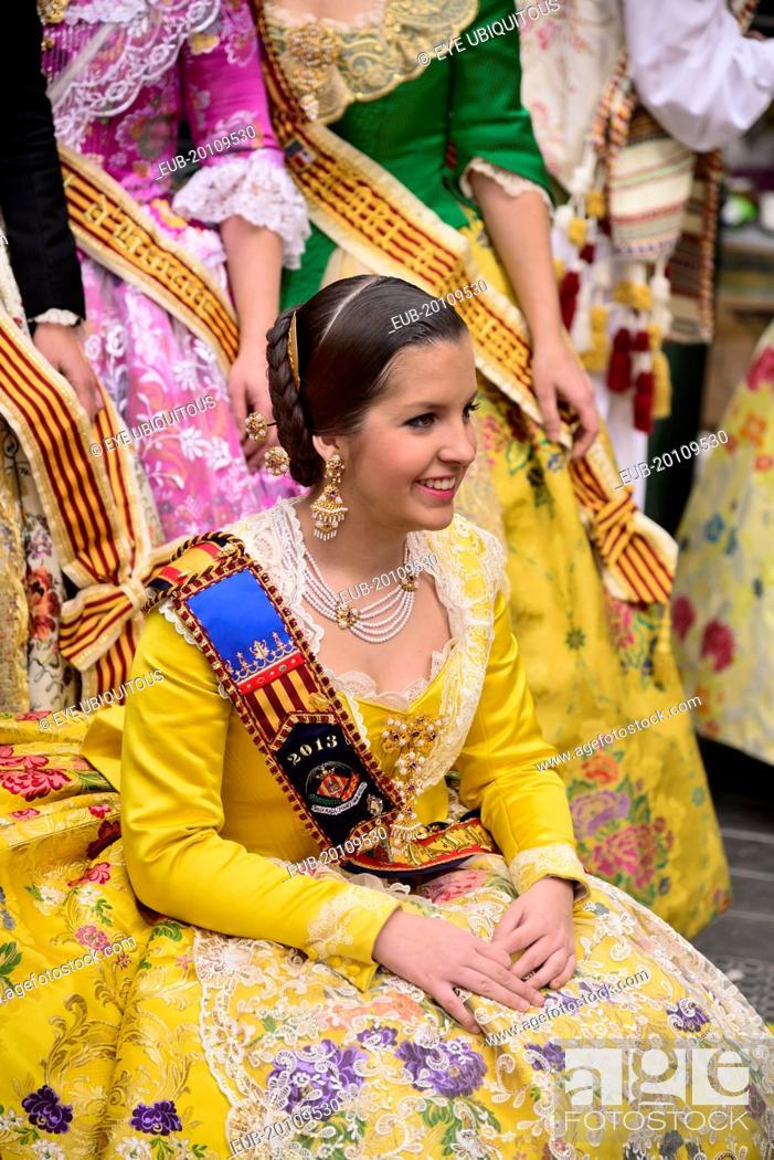 Stock Photo: Reina Fallera in traditional Valencian costume taking a break during Las Fallas festival.