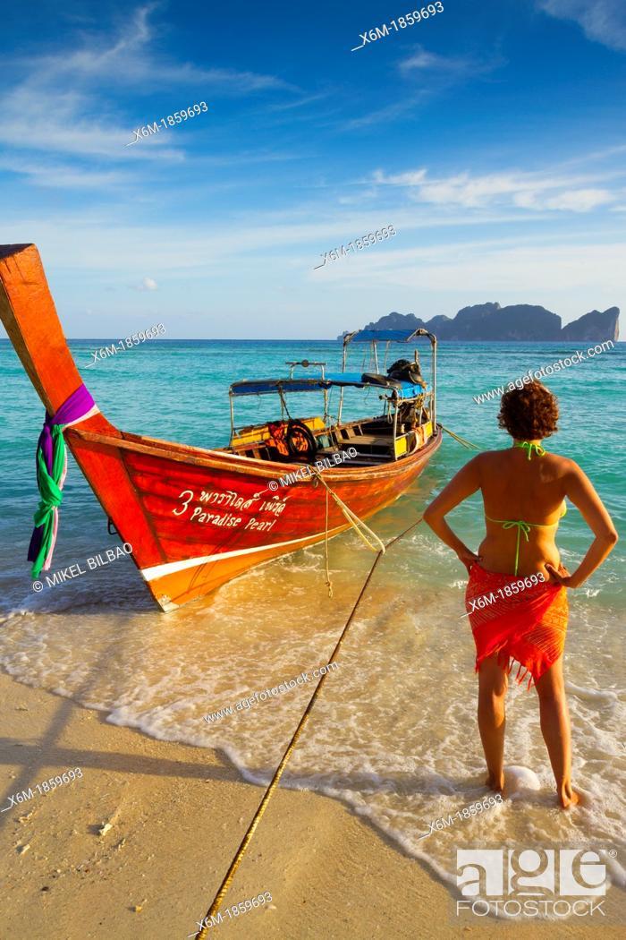 Imagen: Young woman relaxing  Long beach  Phi Phi Don island  Krabi province, Andaman Sea, Thailand.