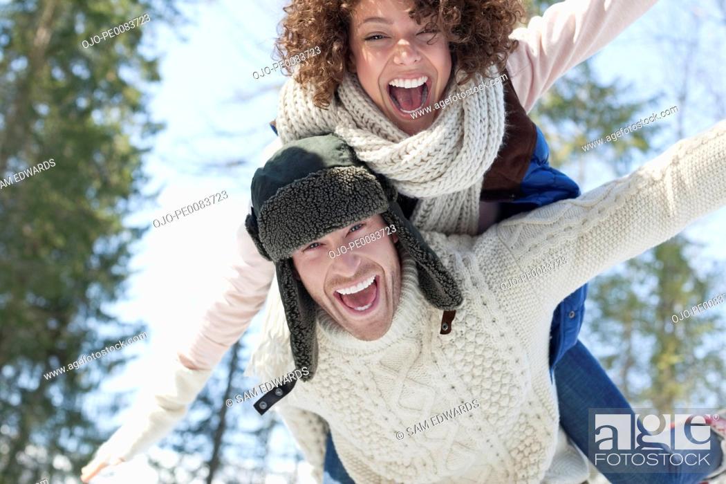 Stock Photo: Enthusiastic couple piggybacking.